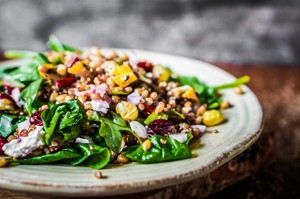 Healthy salad with spinach,quinoa and roasted vegetables